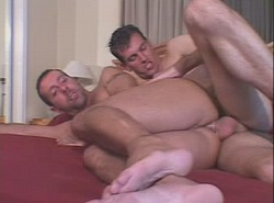Mature bear intensely sucking two dicks simultaneously